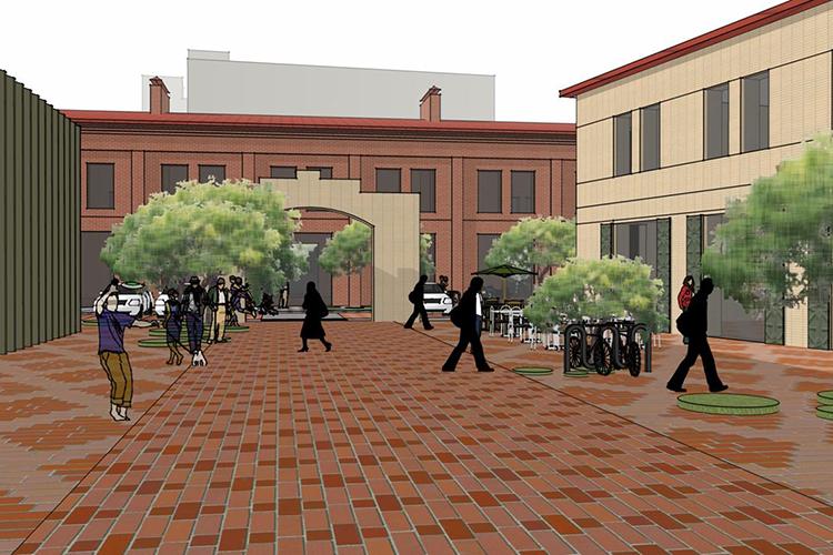 Три двухэтажных здания, которые формируют доступный с улицы внутренний дворик, несут элементы промышленной архитектуры