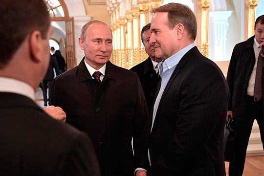 Telegram-каналы обсуждали встречу накануне парламентских выборов наУкраинеПутинасМедведчуком (справа), лидером украинской партии «Оппозиционная платформа-За жизнь» ипосовместительству собственным кумом