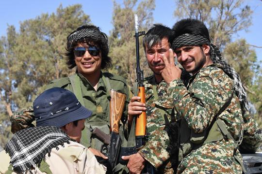«После свержения иубийства ливийского лидера Муаммара Каддафи в2011 году Ливия перестала функционировать как единое государство. Сейчас встране царит двоевластие»