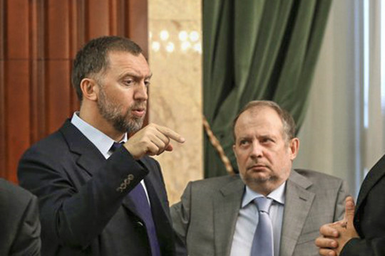 Олег Дерипаска (слева)